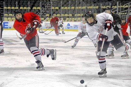 Frozen Four St. Cloud State players warm up at the start of their time on the Consol Energy Center Ice on Wednesday.