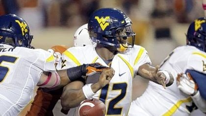 Fumble West Virginia quarterback Geno Smith fumbles the ball as he tries to pass in the second quarter.