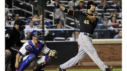 Garrett Jones The Pirates' Garrett Jones hits a three-run home run as Mets catcher Anthony Recker and umpire Sam Holbrook look on in the fifth inning.