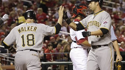 Garrett Jones, Neil Walker The Pirates' Garrett Jones is congratulated by Neil Walker next after his two-run home run in the first inning Tuesday at Busch Stadium.