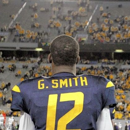 geno Geno Smith and West Virginia will try to put two blowout losses behind them when they play host to TCU Saturday.