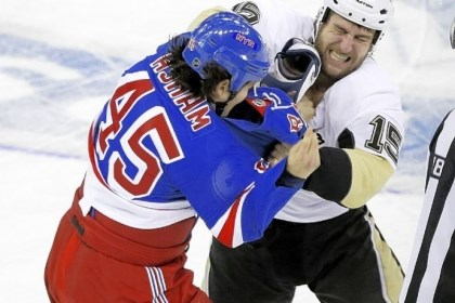 glass New York's Arron Asham tangles with the Penguins' Tanner Glass in the third period. The teams meet again Friday at Consol Energy Center.