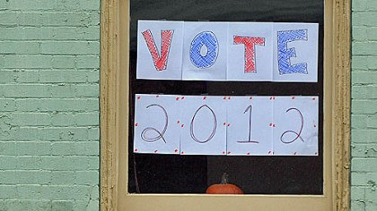 Go vote A sign in a window yesterday in Market Square urges voters to cast their ballot.