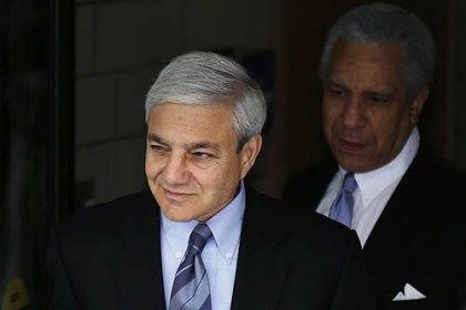 Graham Spanier Former Penn State president Graham Spanier, left, exits the Dauphin County Courthouse Monday.