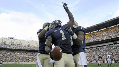 graham2 Pitt's Ray Graham celebrates a touchdown against Virginia Tech with teammates Devin Street and Drew Carswell in the third quarter Saturday at Heinz Field.