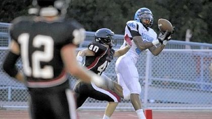 Greene Woodland Hills' Tom Greene caught a touchdown pass against Upper St. Clair in the season opener.