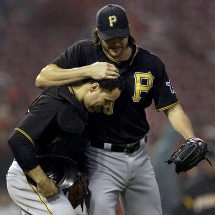 grilli Jason Grilli, right, and Russell Martin celebrate a soggy Pirates victory Saturday in St. Louis.