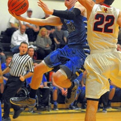 handlan Tyler Handlan of Hempfield dips under Fox Chapel's Matthew D'Amico for a shot Thursday at Montour.