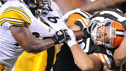 Harrison James Harrison stiff arms the Browns' Steve Heiden.