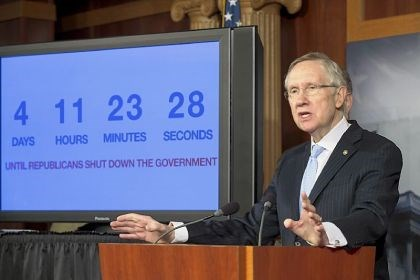 Harry Reid With four days to go before the federal government is due to run out of money, Senate Majority Leader Harry Reid, D-Nev., speaks next to a countdown clock during a news conference on Capitol Hill in Washington on Thursday as Senate Democratic leaders blame conservative Republicans for holding up a stopgap spending bill to keep the government running.