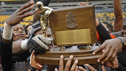 Historic moment The Clairton Bears raise their WPIAL Class A championship trophy after their 58-21 win over Sto-Rox Friday at Heinz Field secured their 60th consecutive victory and a new state record.