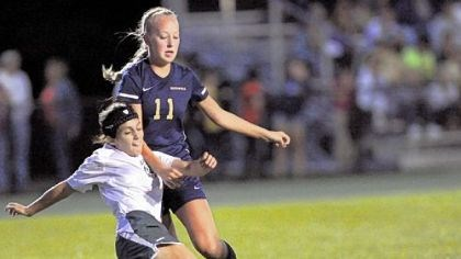 Hopewell Soccer Blackhawk's Lia Vincuguerra kicks the ball away from Hopewell midfielder Abby Losco, right, during a section match last week.