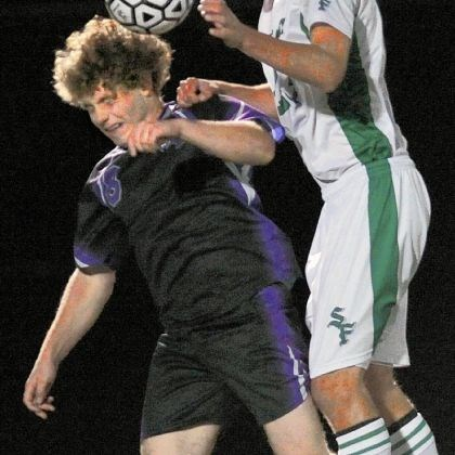 hshigh1 Obama Academy's Ben Eppinger, left, has the ball headed away by South Fayette midfielder Tommy Lagnemma, right, Tuesday at South Fayette. South Fayette won, 5-0.