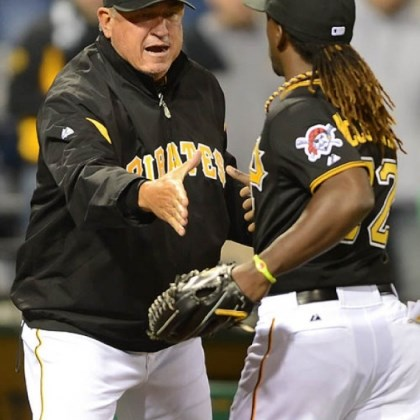 hurdle Pirates manager Clint Hurdle congratulates Andrew McCutchen, who helped save the day with a late home run, after beating the Reds, 6-5.