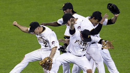 Jack Wilson, Freddy Sanchez, Delwyn Young, Garrett Jones and Andrew McCutchen Pirates shortstop Jack Wilson (2), second baseman Freddy Sanchez, center front and outfielders Delwyn Young, right, Garrett Jones, center middle, and Andrew McCutchen, center rear, celebrate after an 8-5 home win last night.