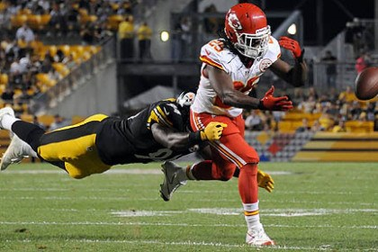 Jamaal Charles and Lawrence Timmons The Chiefs' Jamaal Charles can't pull in a pass as he's defended by the Steelers' Lawrence Timmons in the second quarter.