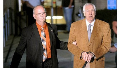 Jerry Sandusky convicted Jerry Sandusky is led in handcuffs by Centre County Sheriff Denny Nau after being found guilty June 23 on 45 counts of sexual abuse at the Centre County Courthouse in Bellefonte.