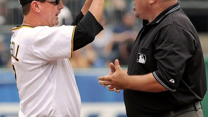 John Russell and Marty Foster Pirates manager John Russell argues a call made by first base umpire Marty Foster.