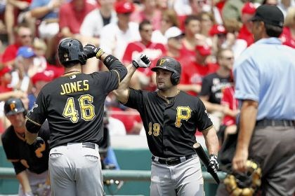 jones Garrett Jones and Michael McKenry celebrate after Jones' home run in the second inning Sunday.