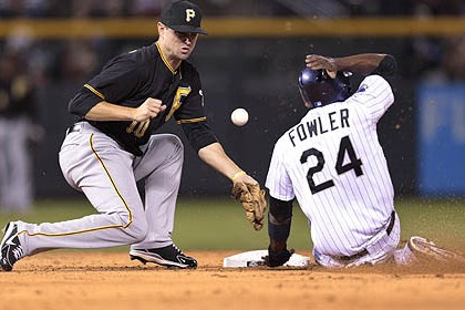 Jordy Mercer The Rockies' Dexter Fowler steals second base as the ball bounces away from Pirates shortstop Jordy Mercer in the third inning.