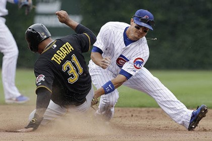 Jose Tabata and Darwin Barney The Pirates' Jose Tabata steals as Chicago Cubs second baseman Darwin Barney applies a late tag.