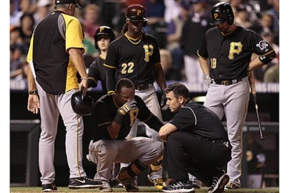 Josh Outman Pirates players watch as medical staff examine Starling Marte's left hand after he was hit by a pitch from Rockies pitcher Josh Outman in the seventh inning Sunday.