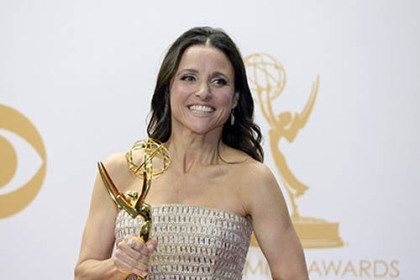 Julia Louis-Dreyfus Julia Louis-Dreyfus holds her Emmy Award for best actress in a comedy during the 65th annual ceremony honoring the best in primetime television.