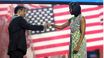 Kal Penn and Michelle Obama fistbump Actor Kal Penn, left, jabs fists with first lady Michelle Obama during an interview at the Time Warner Cable Arena before the official start of the Democratic National Convention in Charlotte.
