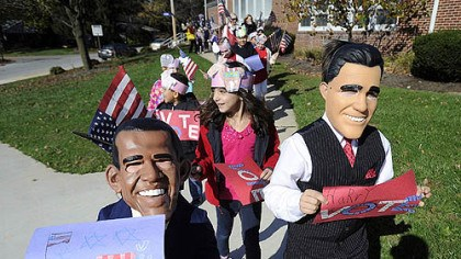 kids masks obama romney york Second-graders Brayden Gentzyel, left, as President Obama and Harry Perkins, right, dressed as Mitt Romney, from Valley View Elementary School in the York Suburban School District in York, Pa., lead a parade of students around the school to encourage people to vote.