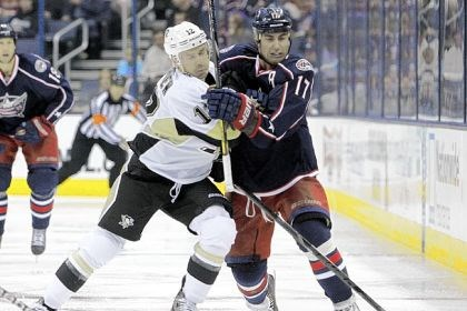kobasew The Penguins' Chuck Kobasew, left, chases a loose puck against the Columbus Blue Jackets' Brandon Dubinsky in a Sept. 15 preseason game. Veteran right winger Kobasew is with the Penguins on a professional tryout.