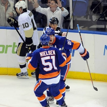 Kyle Okposo The Islanders' Kyle Okposo celebrates his goal against the Penguins with Frans Nielsen in the third period of Sunday's Game 3.