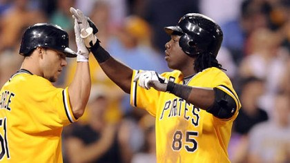 Lastings Milledge and Steve Pearce Pirates' Lastings Milledge is congratulated by teammate Steve Pearce after hitting a home run against the Reds in the fourth inning.