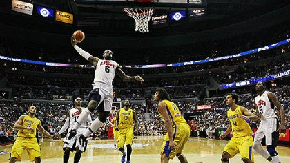 LeBron James dunks Team USA forward LeBron James goes up for a dunk in front of Brazil forward Anderson Varejao during the first half of an Olympic men's exhibition basketball game, July 16, 2012, in Washington. USA won 80-69.