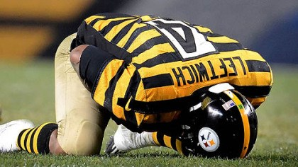 leftwich lying down Steelers quarterback Byron Leftwich holds his left shoulder after getting sacked by Ravens safety James Ihedigbo late in the fourth quarter.