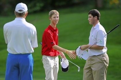 long Indiana's Matt Holuta, left, shakes hands with South Fayette's Corey Long after Long won the fourth extra hole Wednesday at Diamond Run Golf Club in Sewickley.