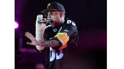 Mac Miller Mac Miller, in a cast from breaking his arm, returns to Pittsburgh and performs at First Niagara Pavilion with fellow Pittsburgh rap artist Wiz Khalifa.
