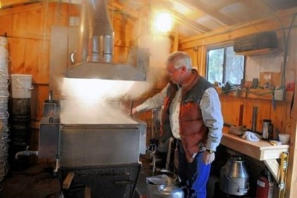 Maple syrup boiler Dan Wingard checks on the maple syrup boiling in a building at his home in Gibsonia.