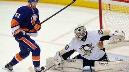 Marc-Andre Fleury Penguins goaltender Marc-Andre Fleury makes a save on the Islanders' Frans Nielsen in the third period.