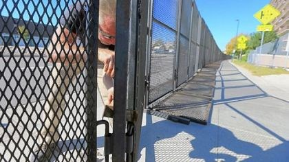 Mark Stahlbaum Mark Stahlbaum works on Tuesday on the security perimeter fence in preparation for tonight's first presidential debate at the University of Denver.