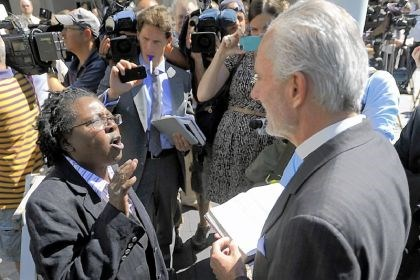 Marriage Stephanie Denise-Carter, left, a supporter of gay marriage, argues with Pastor Bill Devlin, right, outside the Pennsylvania Judicial Center in Harrisburg on Wednesday following the hearing of Montgomery County Register of Wills D. Bruce Hanes, who has issued more than 160 marriage licenses to same-sex couples.