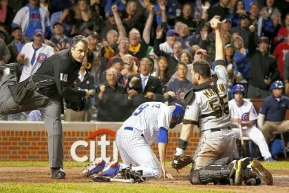 martin Home plate umpire Mike DiMuro calls Chicago Cubs outfielder Nate Schierholtz out at home to end the game as Pirates catcher Russell Martin shows DiMuro the ball in the ninth inning Monday in Chicago.