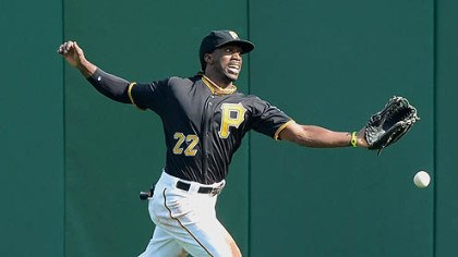 McCutchen Pirates center fielder Andrew McCutchen cannot run down a ball hit by the Reds' Miguel Cairo for a double.