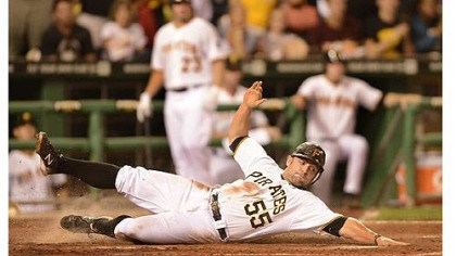 mckenry Catcher Michael McKenry slides safely in to home plate to score one of the Pirates' four runs against the Brewers in the fifth inning Saturday at PNC Park.