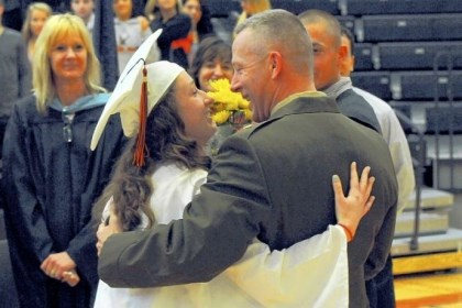 Melanie Burchfield U.S. Marine Corps Maj. Jim Burchfield congratulates his daughter, Melanie, during a mock graduation ceremony Wednesday at Bethel Park High School. Maj. Burchfield's deployment will prevent his attendance at the official ceremony June 16, so the district staged one for the family.