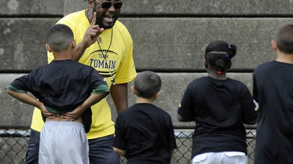Mike Tomlin Steelers head coach Mike Tomlin gives instructions for a running drill at his football camp at Brashear High School in Beechview Thursday.