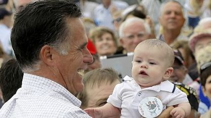 "mitt Mitt Romney picks up a baby wearing a ""Dump Obama"" pin as he campaigns in Pueblo, Colo."