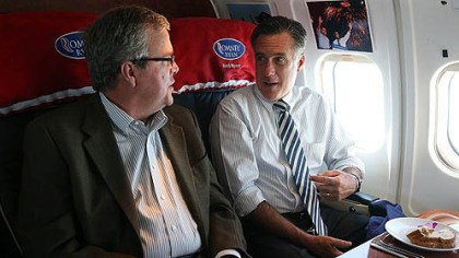 Mitt Romney Republican presidential candidate Mitt Romney talks with former Florida Gov. Jeb Bush aboard his campaign plane on Wednesday en route to Miami.