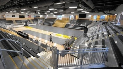 Montour Workers roll up the protective flooring in the gym at the renovated athletic center at Montour High School. Concerts, classes and fitness activities also will be held there.