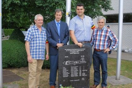 Monument John Tolbert (second from left) and three Belgians who created a monument to the U.S. bomber shot down by Germans in Lummen, Belgium, on Aug. 17, 1943. At far left is Rudy Kenis; Nico Cypers and Koen Luts are to the right of Mr. Tolbert, whose father was on the plane's crew.