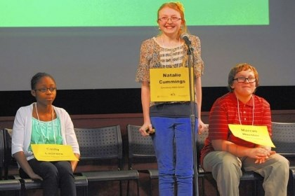 "Natalie Cummings reacts Natalie Cummings reacts after spelling ""gobo"" correctly to win the 63rd annual Western Pennsylvania Spelling Bee on Saturday at Children's Hospital of Pittsburgh of UPMC in Lawrenceville. Emily Laurore, left, came in third and Marcus Huetter came in second."